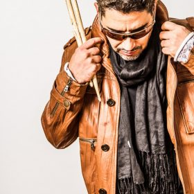 Pablo Batista holding drumsticks